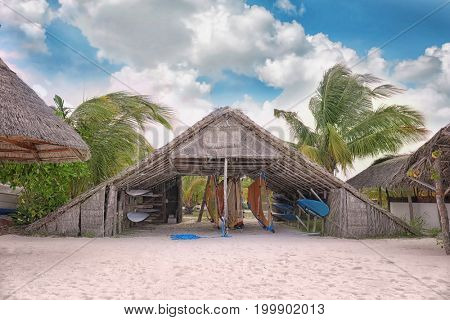 Shelter shed with surf boards on sea beach at tropical resort
