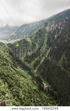 Carpathians nature landscape of rocky Fagaras mountains in cloudy weather at Romania spectacular wilderness scenery.
