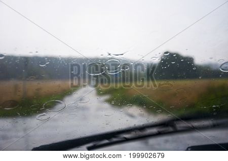 front car window glass and wipers during heavy rain