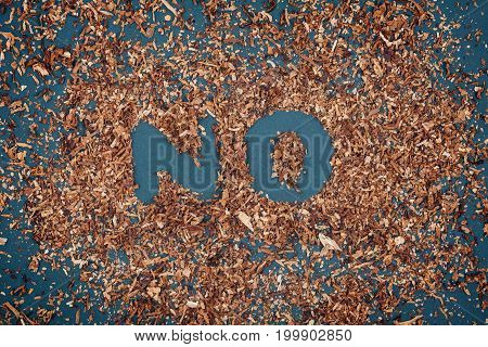 No Smoking Sign Made With Tobacco On Blackboard.