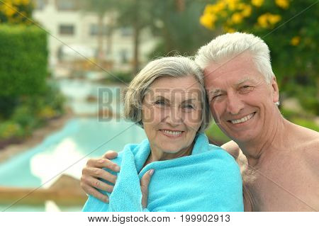 Portrait of a happy senior couple at resort