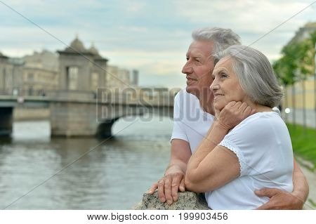 Loving cute senior couple traveling   in city