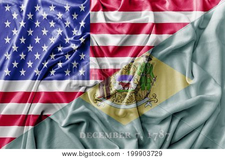 Ruffled waving United States of America and Delaware flag