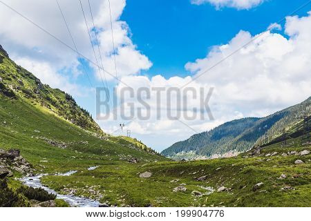 View of the Fagaras mountains and water stream in Carpathians Romania spectacular wilderness scenery.