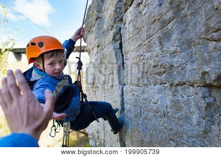 Boy Climber Gives Five.