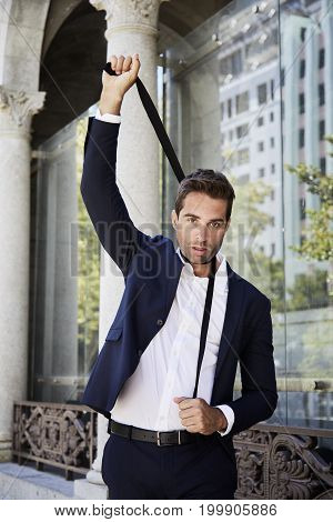 Young Businessman attempting suicide with tie portrait