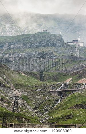 View of the Fagaras mountains with famous and dangerous Transfagarasan road on the height in Carpathians Romania spectacular wilderness scenery.