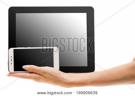 Tablet and phone in female hand on white background isolation