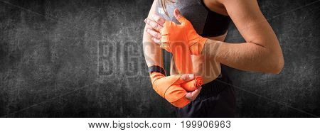 Hands Of Female Fighter Wearing Boxing Bandages