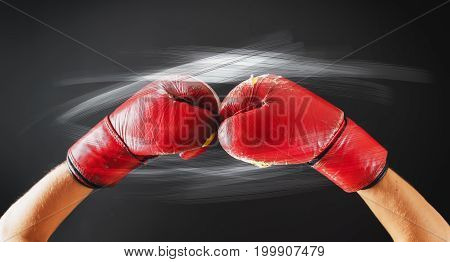 Old Red Boxing Gloves Glow Flashes Dark Background