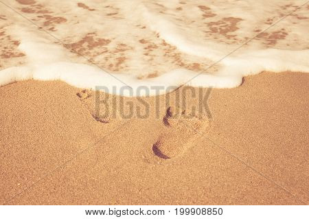 Stamp Of Feet On Sand On The Beach With Sunshine In The Morning, Vintage Color Style