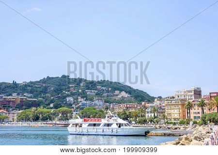 Beautiful view to city and mountains of Rapallo, Italy. Ship on blue water.