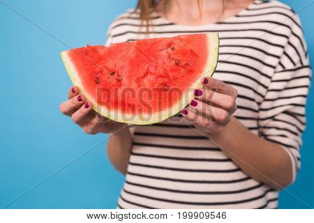 Summer, vacation, diet and vegans concept - Beautiful smiling young woman holding watermelon.