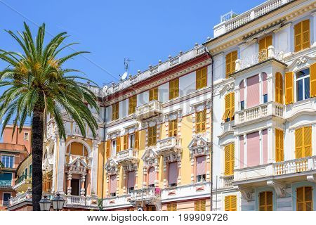 Daylight view to yellow building of hotel and blue sky in Rapallo, Italy