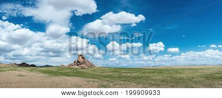 majestic prairie with mountains on background at sunny day