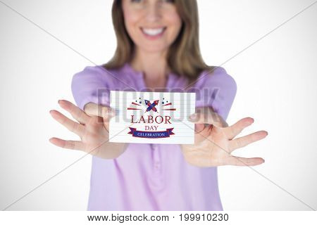 Smiling businesswoman showing blank sign against digital composite image of labor day celebration text