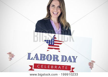 Beautiful businesswoman holding blank billboard over white background against labor day celebrate text and star shape american flag