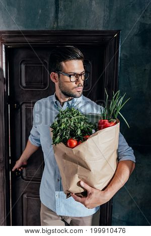 Stylish Young Man Arrived From Grocery Store