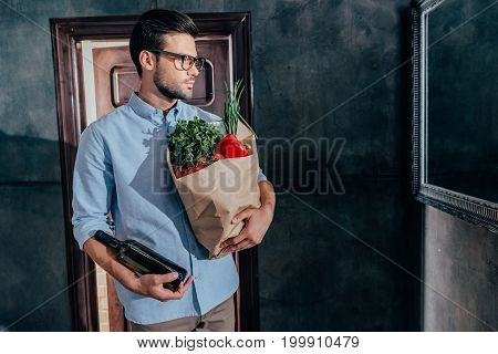 Fashionable Young Man Arrived From Grocery Store