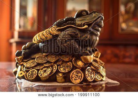 Close up figure of three-legged money frog
