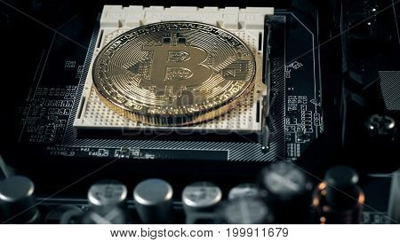 Bitcoins on the motherboard. Crypto currency Gold Bitcoin - BTC - Bit Coin
