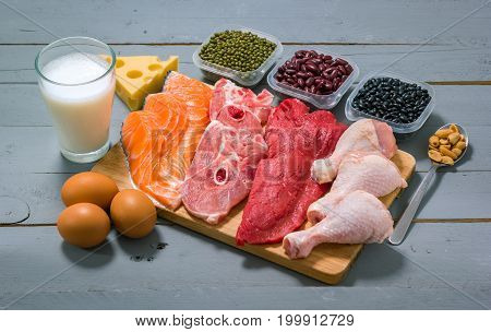 Different types of proteins on a wood table