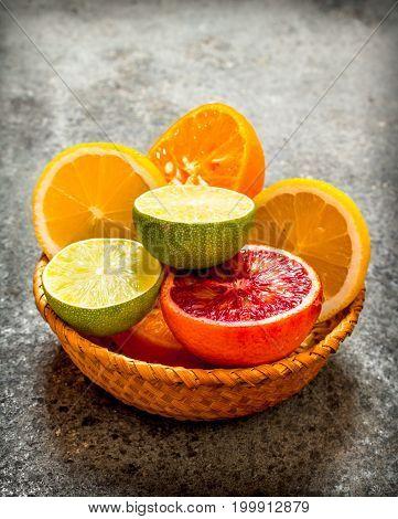 Sliced Citrus Fruits In A Basket.