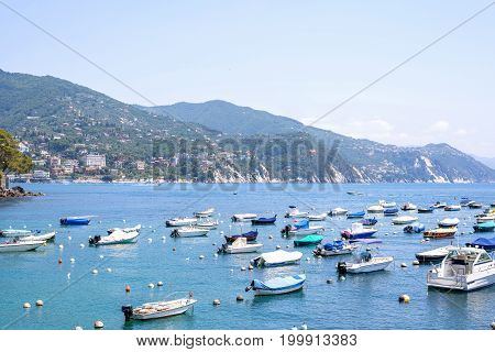 Daylight view to boats on blue water near Rapallo city in Italy.