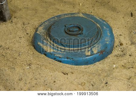 close up on land mine in the sand