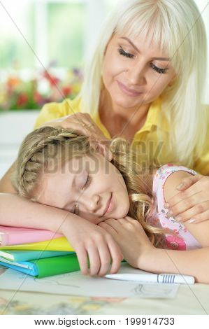 Mother looking at her cute sleeping daughter