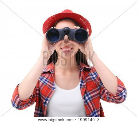 Beautiful young woman with binocular on white background