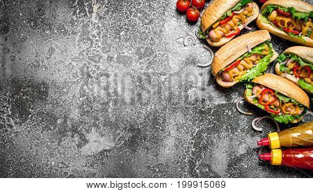 Street Food. Delicious Hot Dogs With Tomato Sauce, Mustard And Herbs.