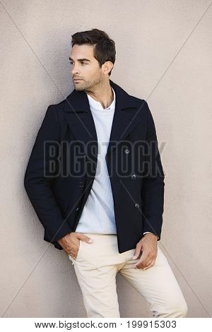 Handsome guy in jacket and looking away