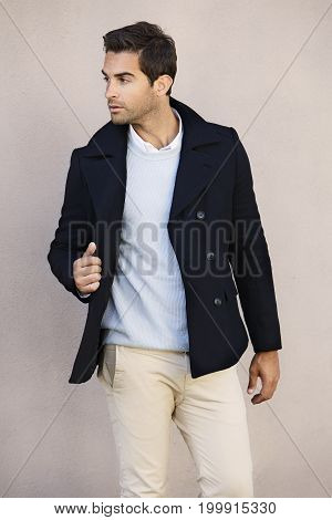 Dude in cool jacket looking away serious