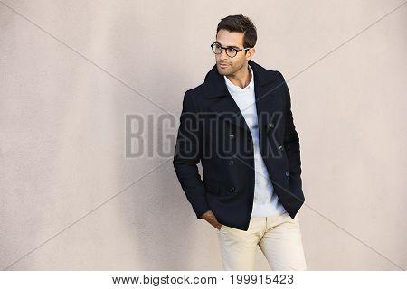 Eyeglasses dude in jacket looking away smiling