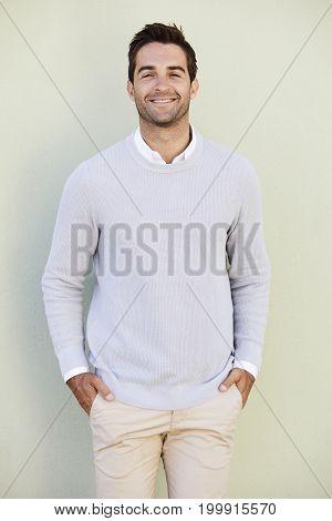 Portrait guy in blue sweater on green background