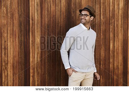 Hat and specs guy against wooden background