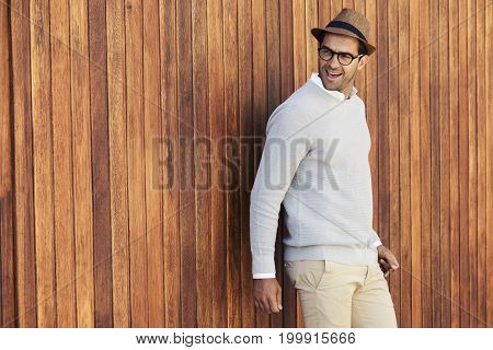 Hat and glasses guy in sweater smiling