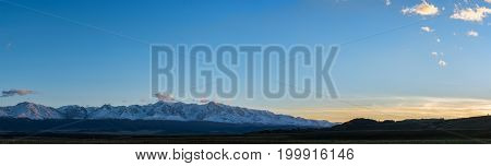 panoramic view of plain at root of mountains at dawn