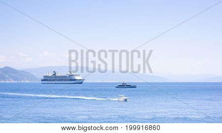 Beautiful daylight view to two boats viewed from sidewalk. Rapallo, Italy