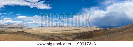 beautiful landscape of sunlit sand dunes against the sky