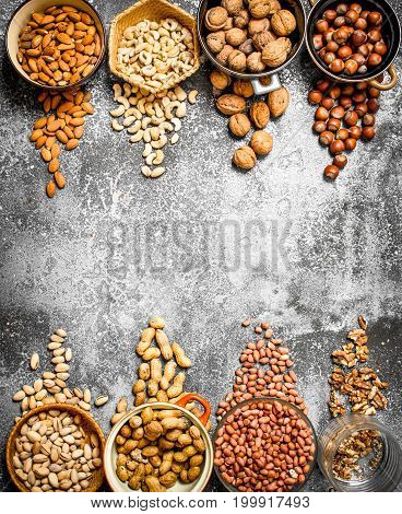 A Lot Of Nuts In Different Bowls.