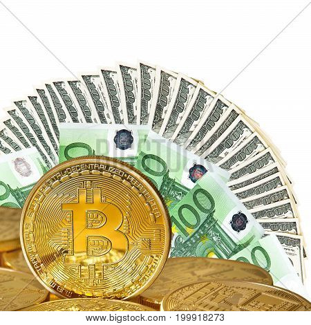Golden Bitcoins close-up on a white background .Euro and dollars currency as a background. Photo (new virtual money ) .Conceptual photo.