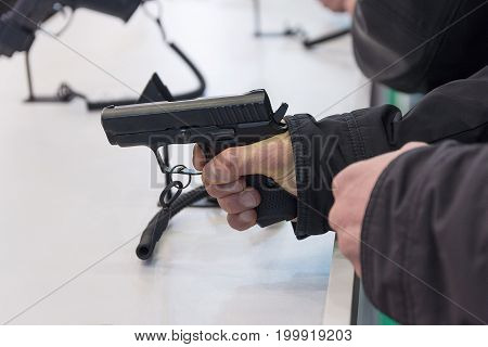 Gun is in the hand at the counter. Weapons