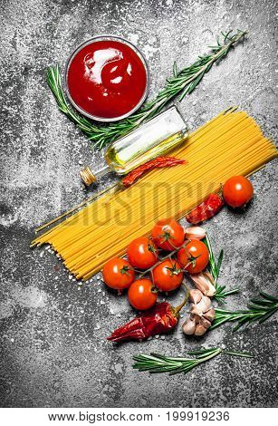 Pasta Background. Spaghetti With Tomato Sauce, Spices And Olive Oil.