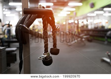 Exercising machine in modern fitness center. Gym equipment background. Shallow depth of field.