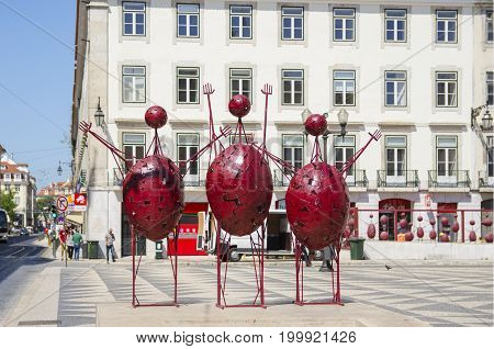 Lisbon PORTUGAL The Praca do Municipio (Municipal square). June 1 2017. Metal sculptures of three red abstract human figures author Jorge Vieira 1998.