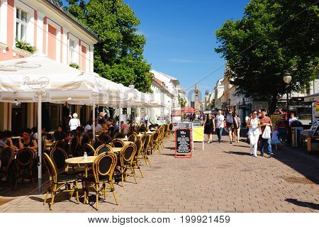 POTSDAM GERMANY - AUGUST 15 2017: View on the Brandenburger Street and Peter and Paul Church in Potsdam.