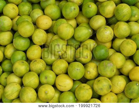 Close up view of green and yellow lemons