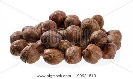 Heap of hazelnut isolated on white background.